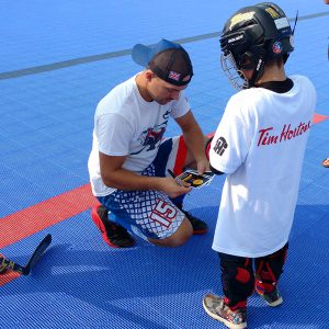 image of: stick skillz academy kid and instructor